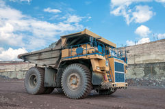 Open cast mine. Picture of big yellow heavy truck in open cast mine Stock Photography
