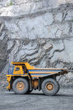 Open cast mine. Picture of big yellow heavy truck in open cast mine Stock Photos