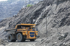 Open cast mine. Picture of big yellow heavy truck in open cast mine Royalty Free Stock Image