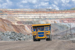 Open cast mine. Picture of big yellow heavy truck in open cast mine Royalty Free Stock Photos