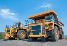 Open cast mine. Picture of big yellow heavy truck in open cast mine Royalty Free Stock Images
