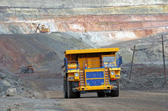 Open cast mine. Picture of big yellow heavy truck in open cast mine Stock Images