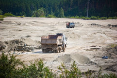Open cast mine pit. One truck,full, goes up and another,empty, goes down Royalty Free Stock Images