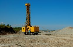 Open cast mining. Drilling machine in open cast mining quarry Royalty Free Stock Photos