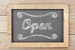 'Open' chalk writing on chalkboard Stock Photos