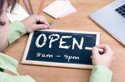 Open. Chalkboard on wooden office desk royalty free stock photo