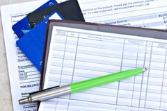 Open checkbook. With pen, credit cards and statement royalty free stock photography