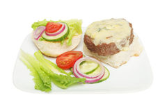 Open cheese burger and salad Royalty Free Stock Photography