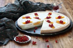 Open Cheese Pie with Peaches and Red Currants. On wooden table Royalty Free Stock Images
