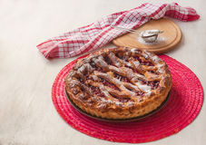 Open cherry pie on the red stand Royalty Free Stock Image