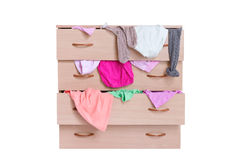 Open chest of drawers full of clothes isolated on white Stock Images