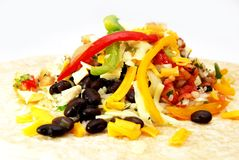 Open Chicken burrito rice and beans Mexican food. Comida mexicana,  Mexican cuisine, chicken burrito rice and beams with peper, burrito de pollo con arroz y Stock Photo