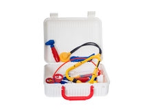 Open Child Medical Kit. Child medical kit to play doctor, open  full of medical supplies, toys in primary colors red, blue, and yellow.  Isolated Stock Images