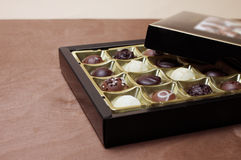Open chocolate box Stock Images