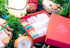 Open Christmas box with sweets and christmas decoration around stock images