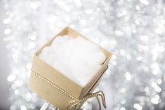 Open christmas gift box with cotton wool Stock Image