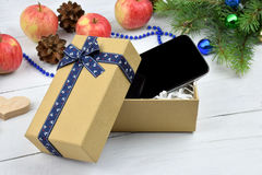 Open Christmas gift box with  a smart phone inside.Christmas. Royalty Free Stock Photography