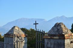 Church gate and a landscape. Open church gate with a cross and a landscape behind it Royalty Free Stock Images