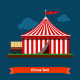 Open circus striped tent with wagon wheel Royalty Free Stock Photo