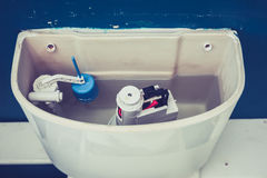 Open cistern of toilet. Toilet cistern in a domestic bathroom stock images