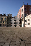 Open city square or plaza. In Venice with a dove in the foreground stock photo