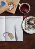 Open a clean blank Notepad, Valentines Day homemade gifts, a Cup of tea and sweets on wooden brown table. Royalty Free Stock Images