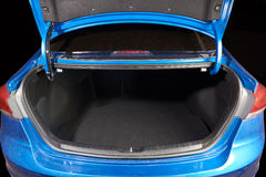 Open clean modern car trunk. Open clean modern blue car trunk close up Stock Photos