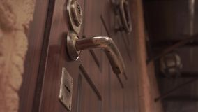 Open and close the door with a key door lock under the door handle
