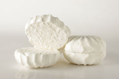Open and close marshmallows  on the bright background. Sweet soft white marshmallows food Stock Photo