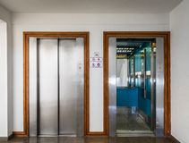 Open and closed chrome metal hotel building elevator doors realistic photo. stock photos