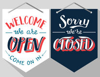 Open and closed hand lettered signs Royalty Free Stock Images
