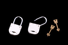 Open and Closed old style padlocks with key Royalty Free Stock Photography