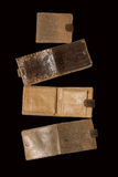 Open and closed purse of snake skin on a black background Stock Photo