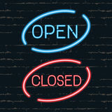 Open, closed signborads. Neon effect in blue and red colors on dark background Royalty Free Stock Images