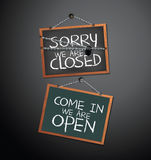 Open and Closed Signs on blackboard hanging with chain. Vector illustration Stock Photos
