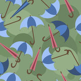 Open and closed umbrellas on a green background, pattern Royalty Free Stock Images