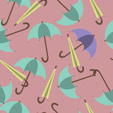 Open and closed umbrellas on a red background, pattern Stock Photos