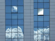 Open and closed windows in an modern glass building with reflection Stock Image