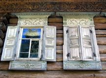Open and closed windows of an old country house. Museum of wooden architecture in Nizhni Novgorod. Russia Stock Image