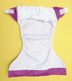 Open Cloth Diaper on Yellow Background royalty free stock photo