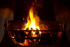 Open coal fire. Coal fire burning in grate in traditional fireplace Royalty Free Stock Photos
