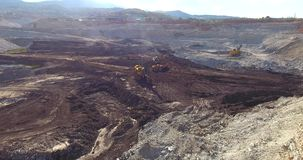 Open Coal Mining Pit and Working Heavy Machines