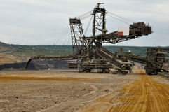 Open pit coal mine - excavator at work Stock Image