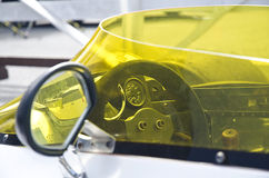 Open cockpit race car with steering wheel and gauges Royalty Free Stock Photo
