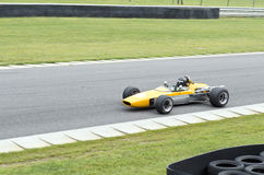 Free Open Cockpit Yellow Racing Car Driving On Track Stock Photography - 55855682