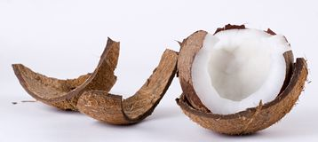 Open coconut and broken husk Royalty Free Stock Photo