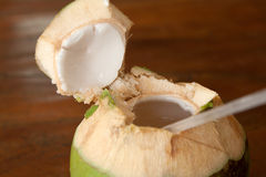 Open coconut with coco milk Stock Photo