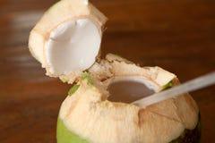 Open coconut with coco milk stock photo