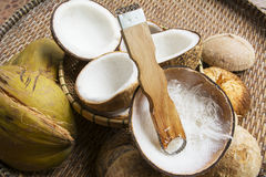 Open coconut with coconut peel. On bamboo mat Royalty Free Stock Images