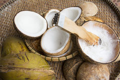 Open coconut with coconut peel. On bamboo mat Royalty Free Stock Photos